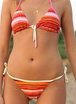 Tanned teen nudist flashing on seaside