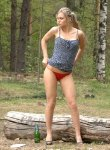 Hot blonde drinks beer and takes a piss outdoors