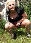 Busty blonde goth babe Edens nude peeing in public